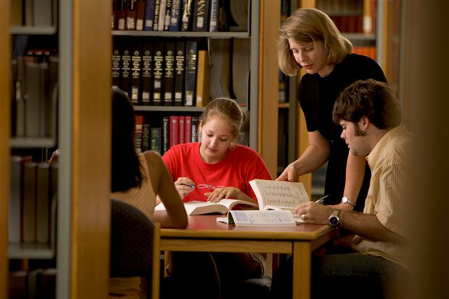 Librarian helping students in the area of research